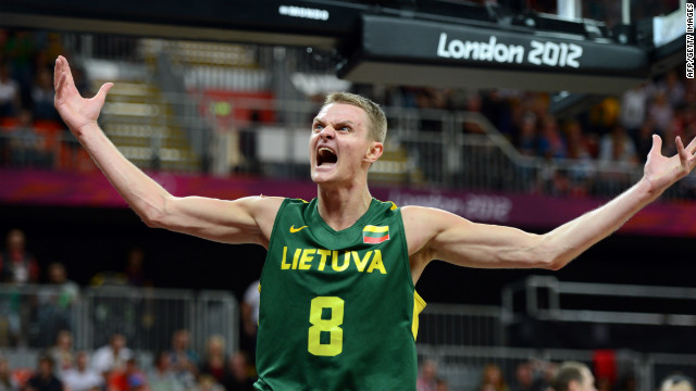Lithuanian guard Renaldas Seibutis celebrates after scoring during the men's basketball preliminary round game against Tunisia.