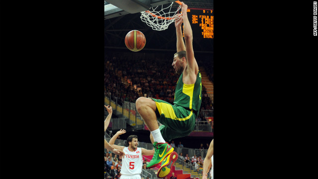 Lithuanian guard Sarunas Jasikevicius scores during the men's basketball preliminary round match against Tunisia.