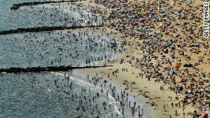 An aerial view of beachgoers taking in the sun at Coney Island in August 2012. (Photo by Mario Tama/Getty Images)