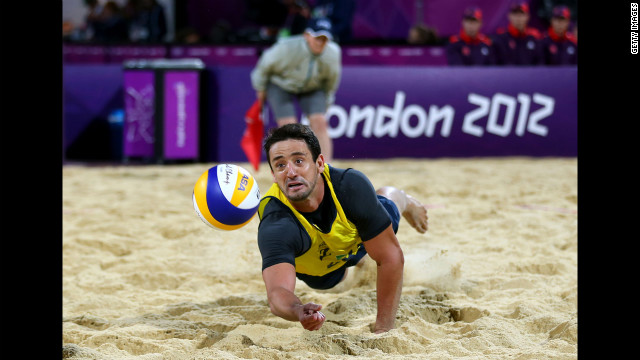 Pedro Cunha of Brazil reaches to hit a return against the German team during the men's beach volleyball quarterfinal.