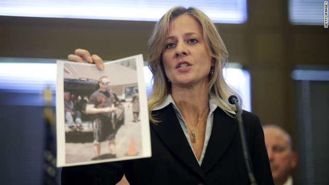 FBI specIal agent in charge, Teresa Carlson, holds a photograph on Monday of a subject the FBI wants to interview and is asking for any information as she speaks at a news conference in Oak Creek.