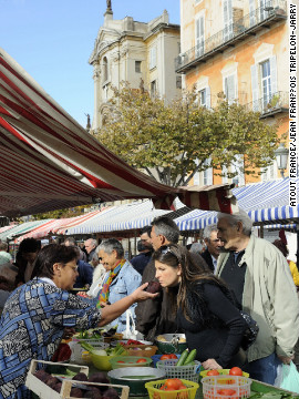 The Cours Saleya outdoor flower and food market operates in the heart of Old Nice Tuesdays through Sundays (Mondays give way to antiques). Colorful buildings, cafes and restaurants line the narrow square.