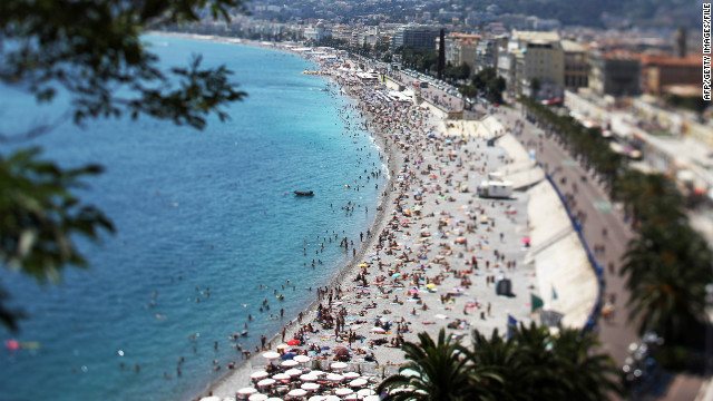 Sunbathers gather en masse during the summer on the beach along Nice's Promenade des Anglais, a wide boulevard and pedestrian walkway along the Mediterranean Sea.