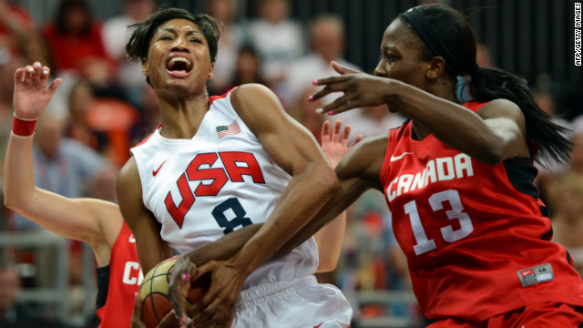 U.S. guard Angel McCoughtry, left, competes against Canadian forward Tamara Tatham during the women's quarterfinal basketball game.