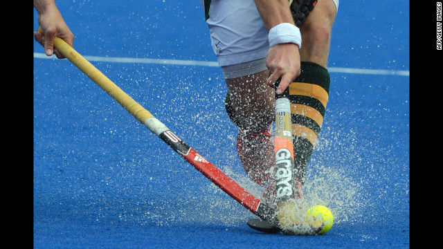 Argentine hockey player Juan Martin Lopez, left, and Lloyd Norris-Jones of South Africa spar for the ball during a field hockey preliminary match.