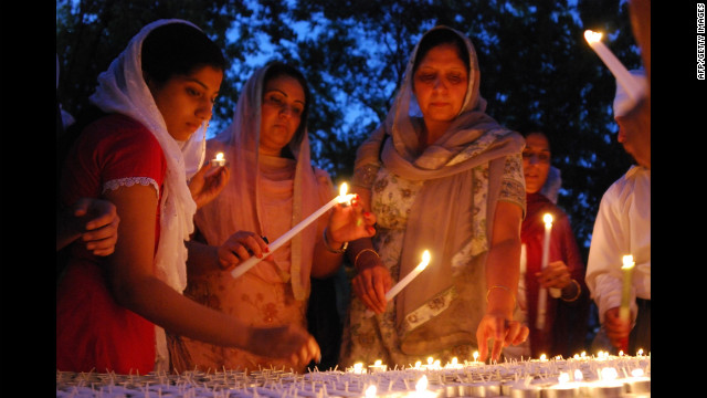 Members of Wisconsin's Sikh community conduct a candlelight vigil on Monday, August 6, for six people killed in Sunday's attack on a Sikh temple in suburban Milwaukee.