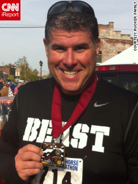 Rucker shows off the medal he received for completing a half marathon on October 23, 2011.