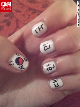 "Da-Hae West lives in London, but is originally from South Korea. Her thumb features the South Korean flag, and the rest of her fingers <a href='http://ireport.cnn.com/docs/DOC-825451'>spell out</a> ""Republic of Korea"" in Korean."