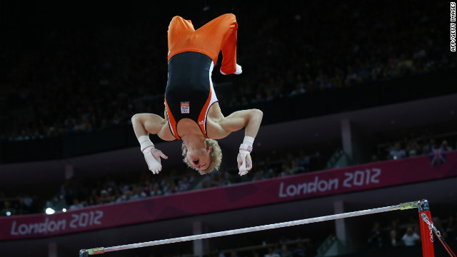Netherlands' Epke Zonderland catches air during the men's horizontal bar final.
