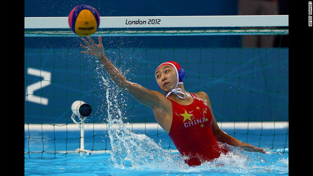 Goalkeeper Jun Yang of China makes a save against Italy during the women's water polo semifinal match.