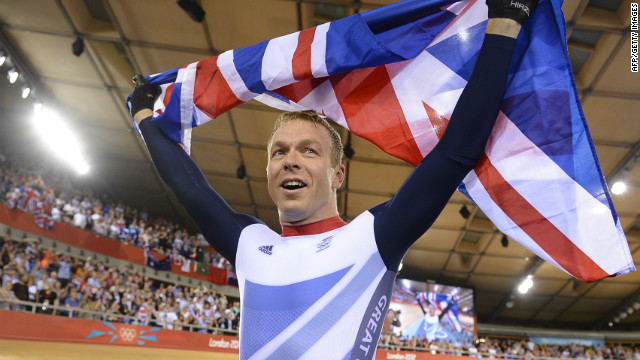 Chris Hoy poses with the Union Jack after becoming the most decorated Olympian in British history