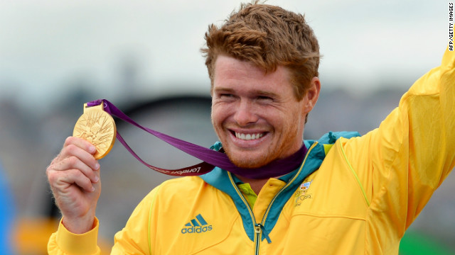 Tom Slingsby celebrates on the podium after winning gold in the Laser sailing class on August 6.
