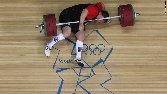 Matthias Steiner of Germany lies on the floor after failing to lift in the men's +105 kilogram weightlifting final.
