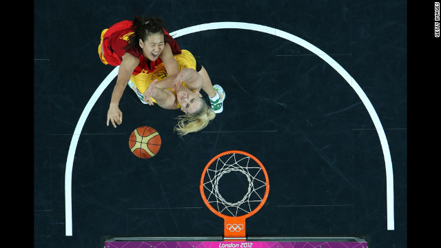 Song Gao, No.12 of China, shoots over Lauren Jackson, No. 15 of Australia, during the women's basketball quaterfinal.