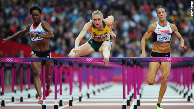 Sally Pearson of Australia leads Tiffany Porter of Great Britain and Jessica Zelinka of Canada in the women's 100-meter hurdles semifinals.