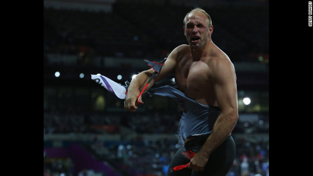 Robert Harting of Germany celebrates winning gold in the men's discus throw final.