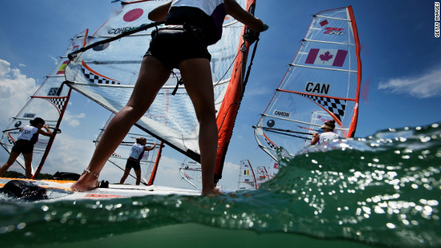 The windsurfing lobby argues that kiteboarding lacks a clear pathway from junior to professional level, something that windsurfing has worked years to achieve. These teenage girls are competing in the Techno 293 windsurfer class at the Youth Olympics in Singapore.