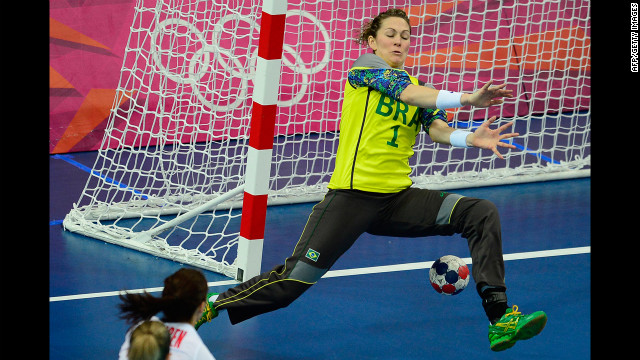 Brazil's goalkeeper Chana Masson tries to make a save during the women's quarterfinal handball match against Norway.