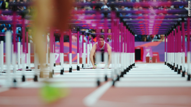 Andrew Pozzi of Great Britain watches after pulling out of the men's 110-meter hurdles round 1 heats.