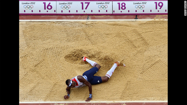 Phillips Idowu of Great Britain competes in the men's triple jump qualification. Check out photos from <a href='http://www.cnn.com/2012/08/08/worldsport/gallery/olympics-day-twelve/index.html' target='_blank'>Day 12 of the competition</a> from Wednesday, August 8.