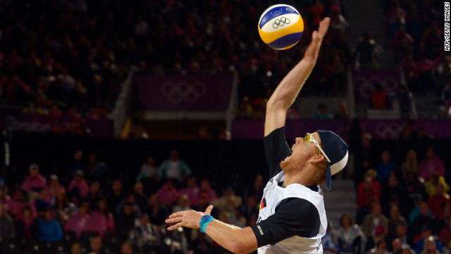 Germany's Jonas Reckermann serves during the men's beach volleyball semifinal against Reinder Nummerdor and Rich Schuil from Netherlands on Tuesday, August 7. Check out Day 10 of competition from Monday, August 6. The Games ran through August 12.