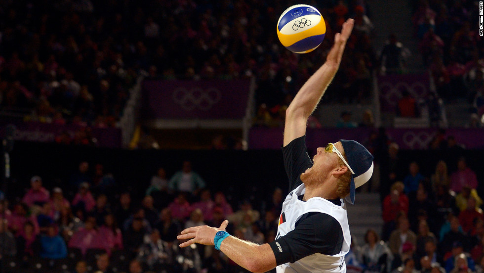 Germany's Jonas Reckermann serves during the men's beach volleyball semifinal against Reinder Nummerdor and Rich Schuil from Netherlands on Tuesday, August 7. <a href='http://www.cnn.com/2012/08/06/worldsport/gallery/olympics-day-ten/index.html'>Check out Day 10 of competition</a> from Monday, August 6. The Games ran through August 12.