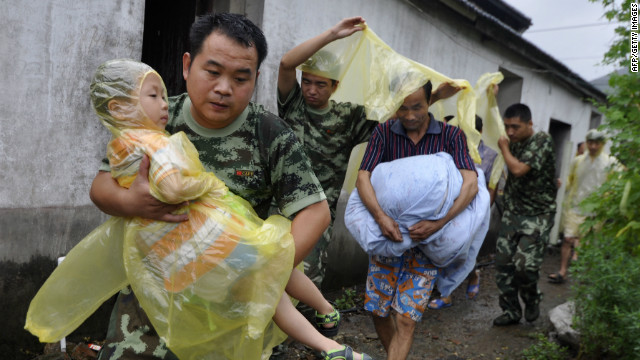 Residents evacuate from their homes in Zhoushan, east China's Zhejiang province as Tropical Storm Haikui approahces.