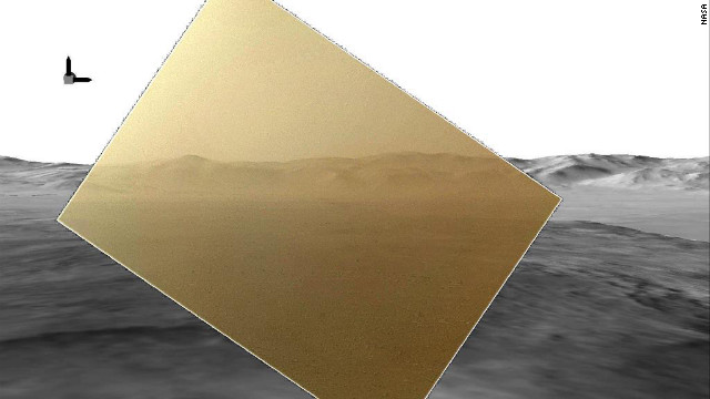 The color image captured by NASA's Mars rover Curiosity on August 7, 2012, has been rendered about 10% transparent so that scientists can see how it matches the simulated terrain in the background.