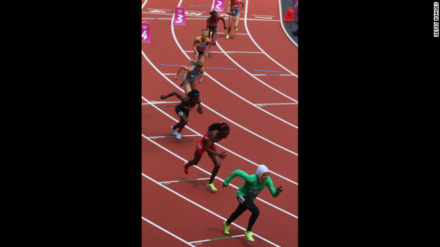 Saudi Arabia's Sarah Attar, right, competes in round one of the women's 800-meter heats.