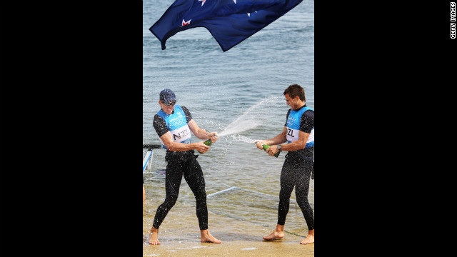New Zealand's Peter Burling, left, and Blair Tuke celebrate winning silver in the men's 49er sailing final in Weymouth, England.