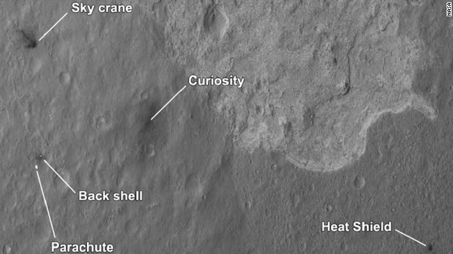 The four main pieces of hardware that arrived on Mars with NASA's Curiosity rover were spotted by NASA's Mars Reconnaissance Orbiter (MRO). The High-Resolution Imaging Science Experiment (HiRISE) camera captured this image about 24 hours after landing.