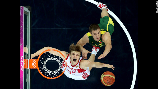 Russia's Andrei Kirilenko, left, and Paulius Jankunas of Lithuania go up for a rebound during the men's basketball quarterfinal game.