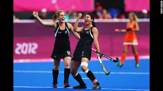 New Zealand's Ella Gunson, left, and Kayla Sharland celebrate after Sharland scores their team's first goal during the women's field hockey semifinal match against the Netherlands.