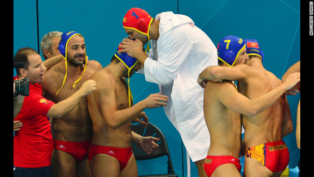 Montenegro's water polo team celebrates its victory over Spain during the men's water polo quarterfinal match.