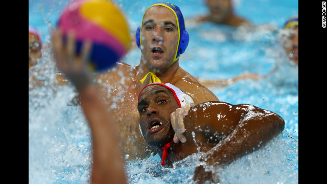 Nikola Janovic, top, of Montenegro and Ivan Perez Vargas of Spain compete in the men's water polo quarterfinal match.