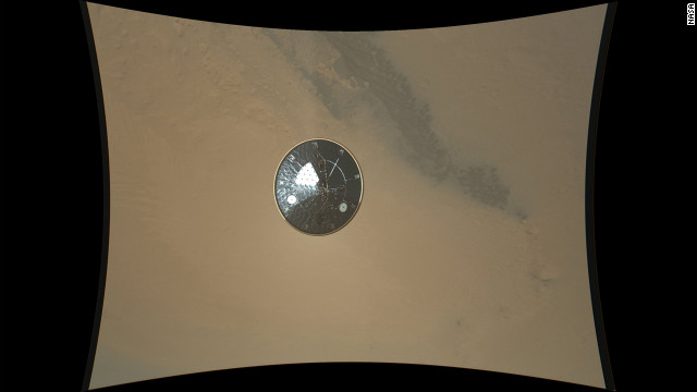 This color full-resolution image showing the heat shield of NASA's Curiosity rover was obtained during descent to the surface of Mars on Monday, August. The image was obtained by the Mars Descent Imager instrument known as MARDI and shows the 15-foot diameter heat shield when it was about 50 feet from the spacecraft.
