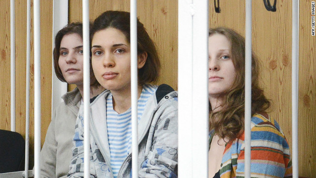 Members of female punk band 'Pussy Riot' sit behind the bars during a ...