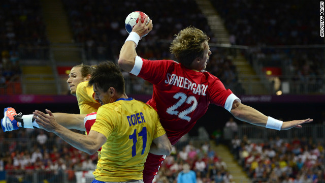 Denmark right back Kasper Sondergaard Sarup, center, shoots during the men's quarterfinal handball match against Sweden at the London Olympics on Wednesday, August 8.