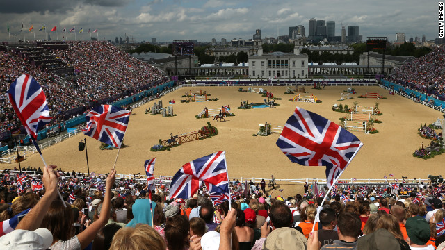 Fans cheer the individual jumping equestrian event on Wednesday.