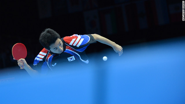 South Korea's Joo Se-Hyuk returns a ball to China's Zhang Jike during the table tennis men's team final.