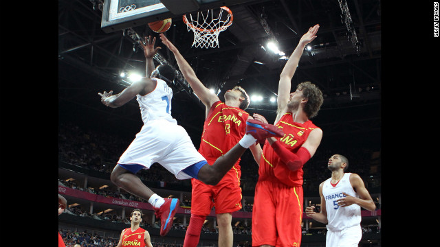 Florent Pitrus of France goes up for a shot against Marc Gasol of Spain in the first half of their men's basketball quarterfinal game.