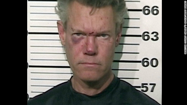 Musician Randy Travis was arrested in 2012 for misdemeanor DWI and felony retaliation after he was involved in a one-vehicle accident and found buck naked in the roadway. He was later released on bond.