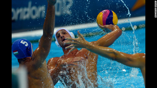 Italian water polo player Valentino Gallo faces off with Hungarian Tamas Kasas, left, during the men's quarterfinal match.