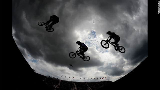 Exhibition riders perform on the BMX track.