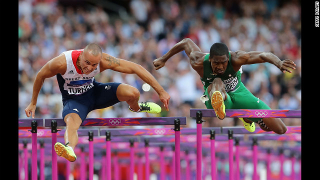 British hurdler Andrew Turner and Nigeria's Selim Nurudeen compete in the men's 110-meter hurdles semifinal.