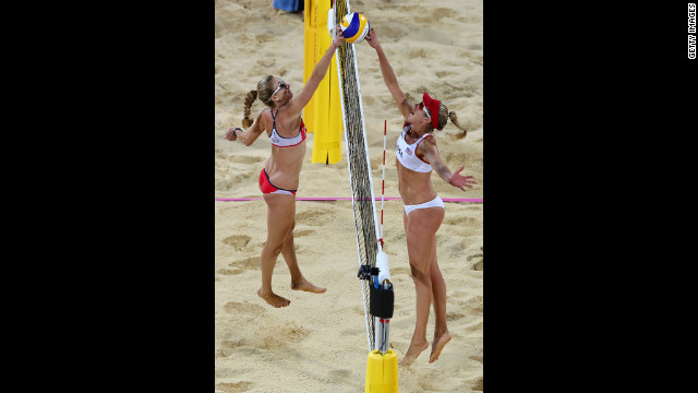 Kerri Walsh Jennings of the United States, left, competes against countryman April Ross during the women's beach volleyball match on Wednesday.