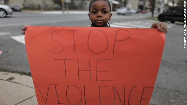 Donte Jones, 5, shares a message written on a handmade sign.