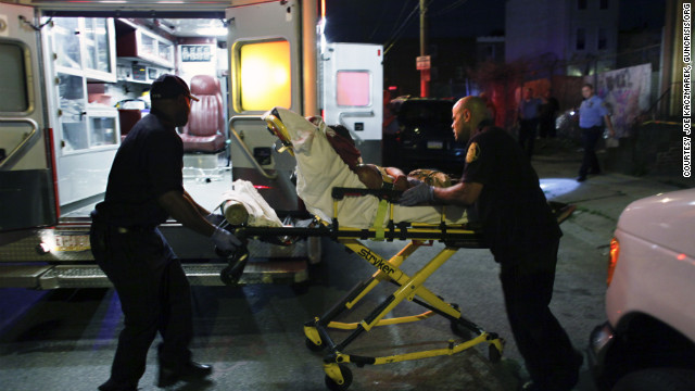 Paramedics treat and transport an 18-year-old man who accidentally shot himself in the head in June.