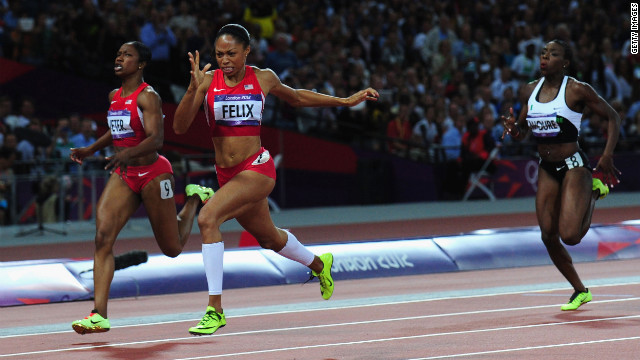 Allyson Felix of the United States crosses the finish line ahead of Murielle Ahoure of Cote d'Ivoire and Carmelita Jeter of the United States to win the women's 200-meter final on Wednesday.