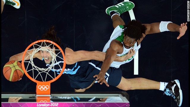 Argentinian forward Luis Scola, left, tries to score past Brazilian center Nene Hilario during the quarterfinal basketball match.
